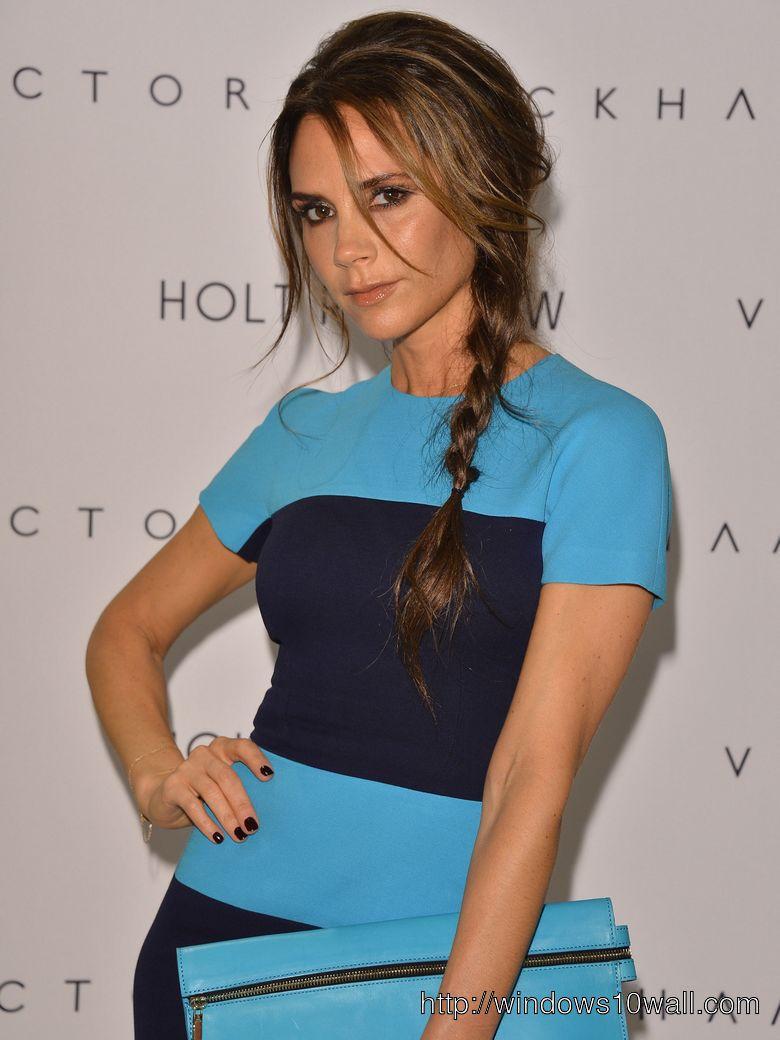 Victoria Beckham in Blue Sexy Dress Background Wallpaper