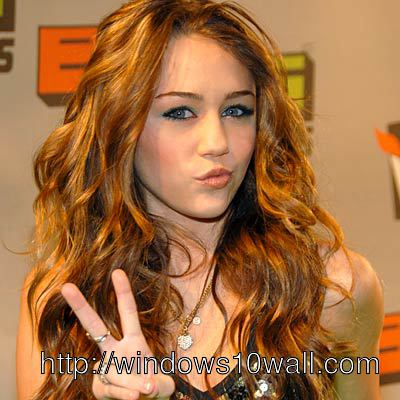 Miley Cyrus showing Winning Face Background Wallpaper