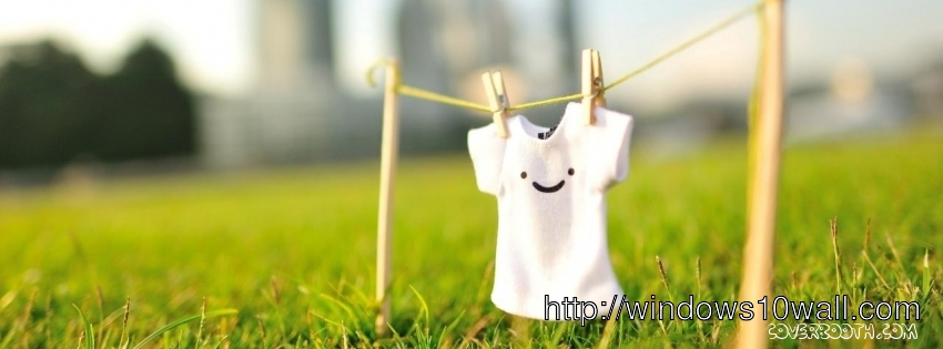 white tshirt with smiley hanged over green meadow facebook timeline background cover