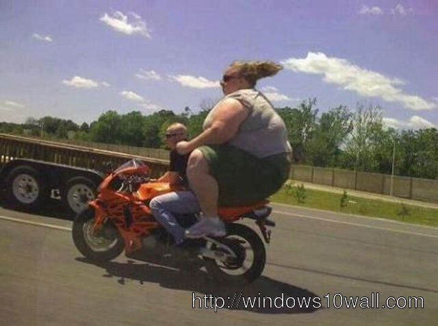Funny Bike with Huge Girl sitting Wallpaper