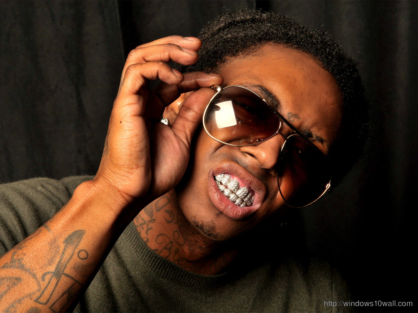 Lil Wayne Playing with Glasses Background Wallpaper