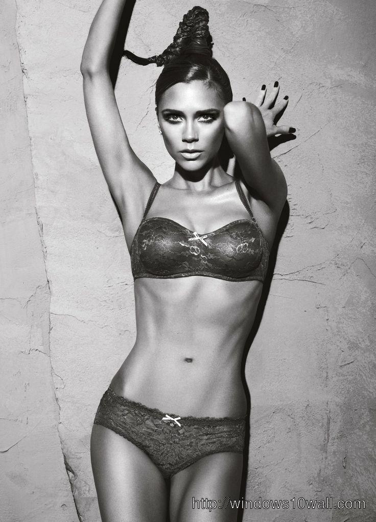 Victoria Beckham In Bikini Background Wallpaper