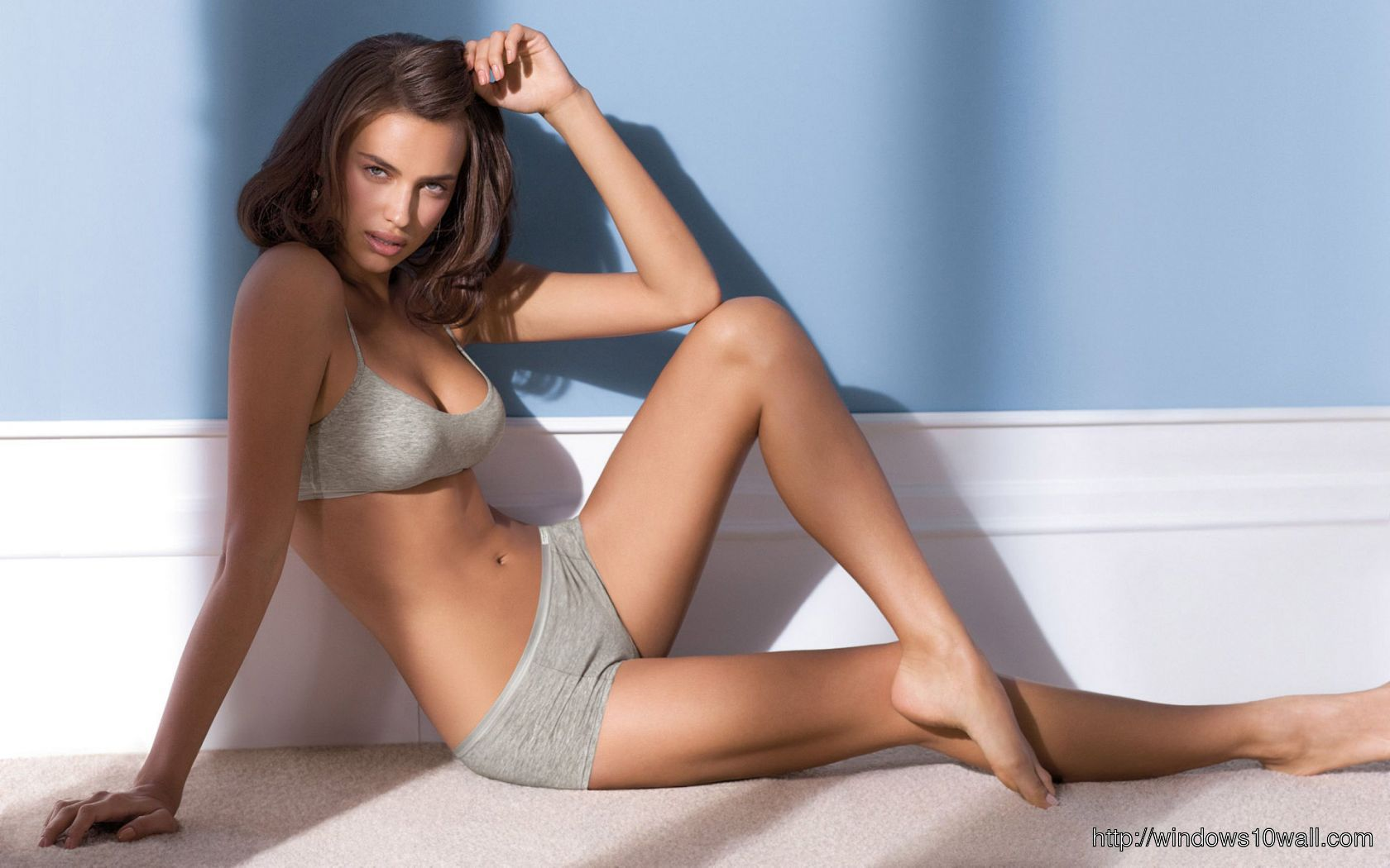 Irina Shayk on floor background Wallpaper