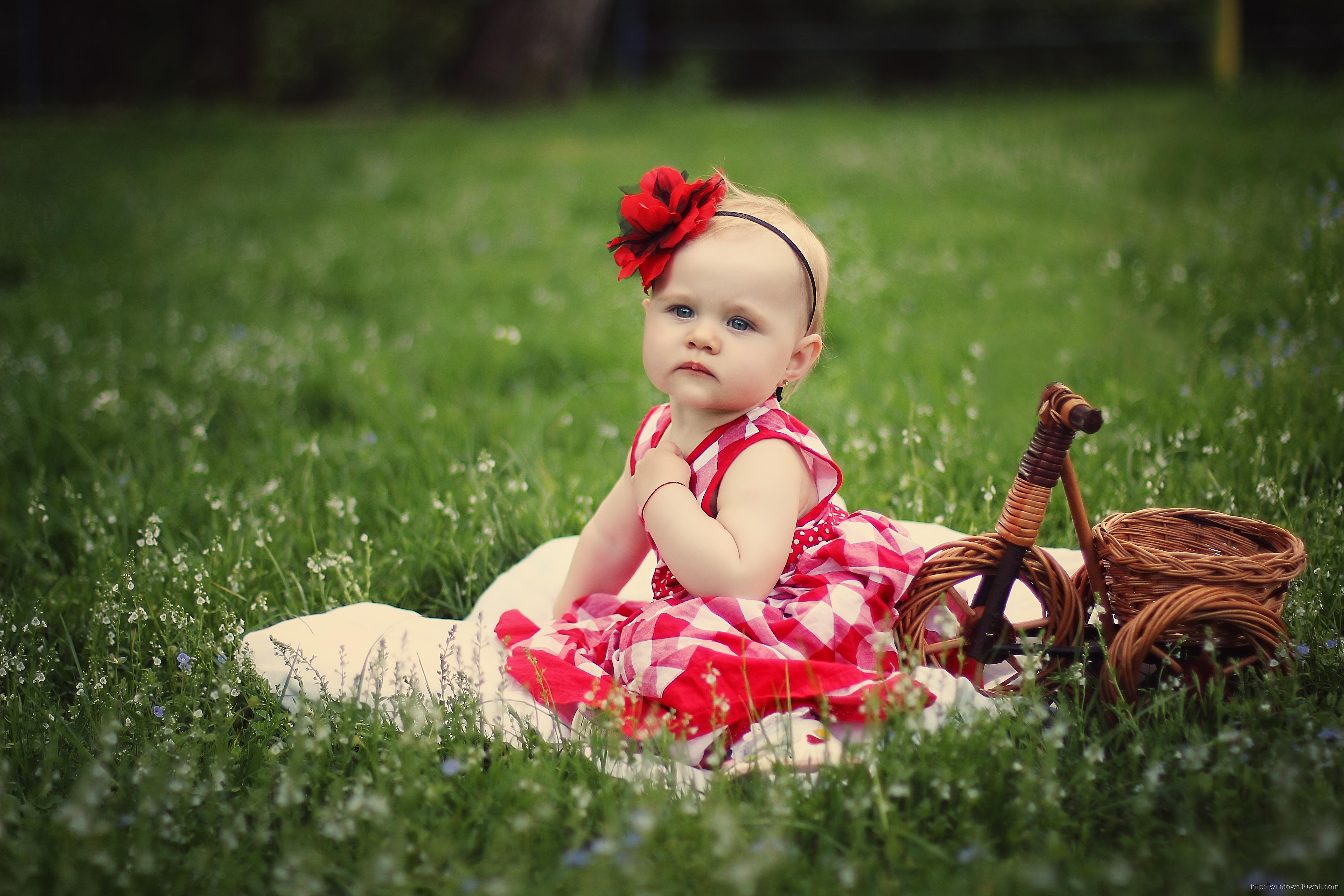 Cute Baby Girl In Field Wallpaper