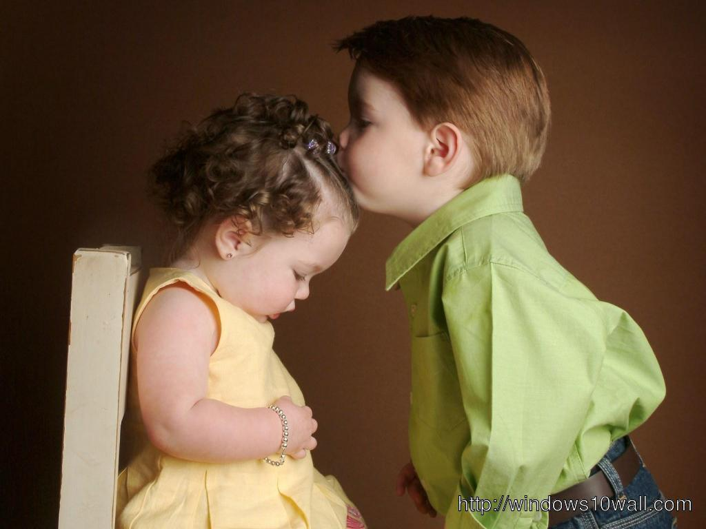 Cute Baby Couple Kissing on Head Wallpaper